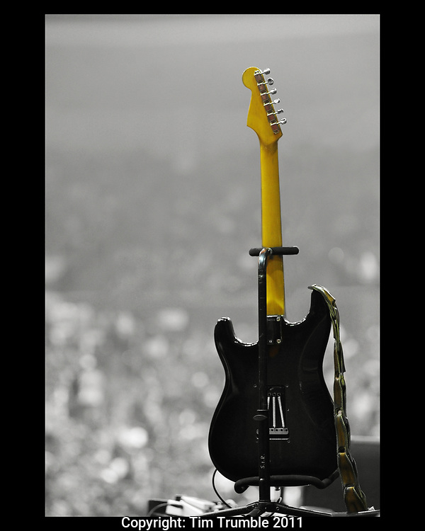 Yellow neck Fender Stratocaster guitar sitting on stage before a concert