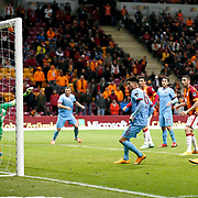 Trabzonspor's Carl Medjani (C) scores during their Turkish superleague soccer derby match Galatasaray between Trabzonspor at the AliSamiYen spor kompleksi TT Arena in Istanbul Turkey on Saturday, 22 November 2014. Photo by Aykut AKICI/TURKPIX
