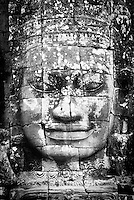 The smiling stone face of the bodhisattva Avalokiteshvara at The Bayon temple in the walled city of Angkor Thom, Siem Reap, Cambodia