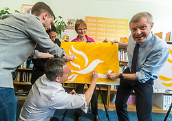 Willie Rennie visits mental health charity, Health In Mind and takes part in painting Liberal Democrat Logos before officially launching the Manifesto for the 2017 General Election.<br /> <br /> Pictured: Alex Cole-Hamilton MSP, Aisha Mir, Candidate for Edinburgh South West, Elizabeth Riches candidate for North East Fife and Willie Rennie