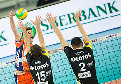 Eric Mochalski of ACH vs Mateusz Mika of Lotos Trefl Gdansk and Wojciech Grzyb of Lotos Trefl Gdansk during volleyball match between ACH Volley (SLO) and Lotos Trefl Gdansk (POL) in 3rd Leg of Pool F of 2016 CEV DenizBank Volleyball Champions League, on December 3, 2015 in Arena Stozice, Ljubljana, Slovenia. Photo by Vid Ponikvar / Sportida