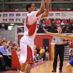 Jan 31, 2009; Piscataway, NJ, USA; Rutgers guard Mike Rosario (3) passes to teammate center Hamady N'Diaye (not pictured) during the first half of Rutgers' 75-56 victory over DePaul in NCAA college basketball at the Louis Brown Athletic Center