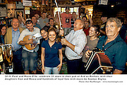Paidi and Maire O'Se crack open the champagne to celebrate 25 years in their pub at Ard an Bothair, Ventry,County Kerry on Saturday with their daughters Siun and Neasa. Hundreds of loyal fans and members of the Haughey family attended the celebration with music by Seamus Begley on right..Picture by Don MacMonagle