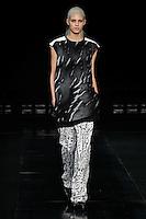 Devon Windsor walks the runway wearing Helmut Lang Fall 2014 in New York on February 7th, 2014