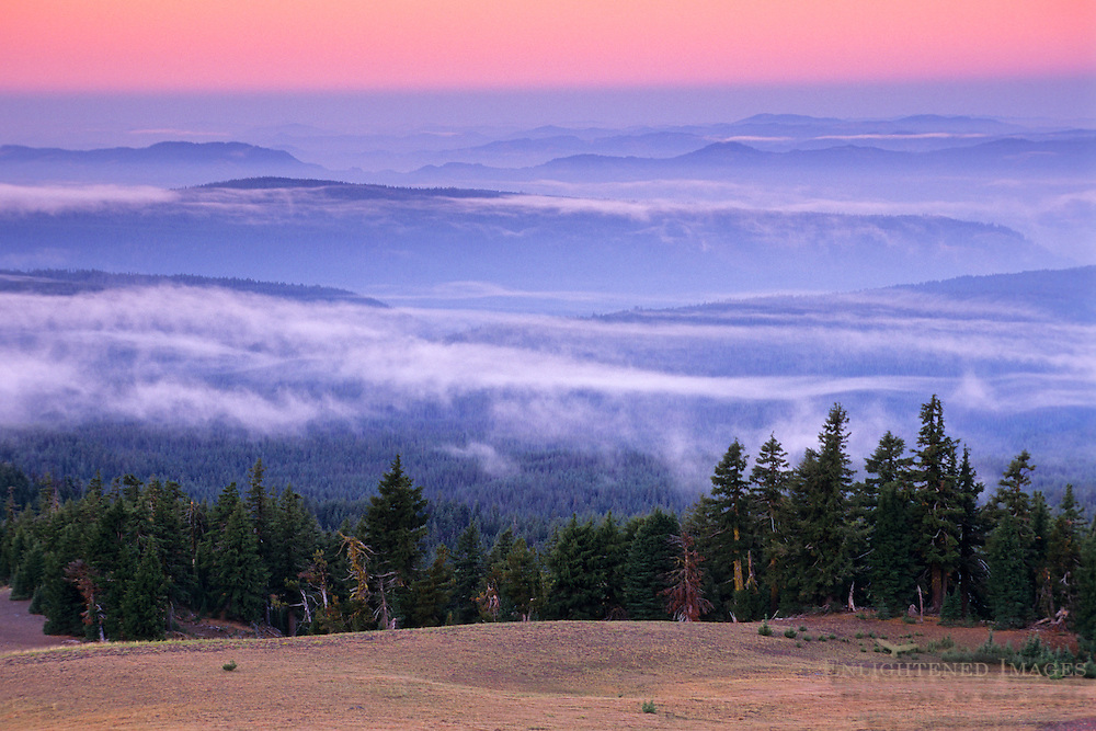 Clouds at dawn over hills from the rim of Crater Lake, Crater Lake National Park, Oregon