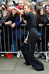 © Licensed to London News Pictures. 21/02/2016.  KARLIE KLOSS arrival for the Top Shop Unique show at the London Fashion Week Autumn/Winter 2016 show. Models, buyers, celebrities and the stylish descend upon London Fashion Week for the Autumn/Winters 2016 clothes collection shows. London, UK. Photo credit: Ray Tang/LNP
