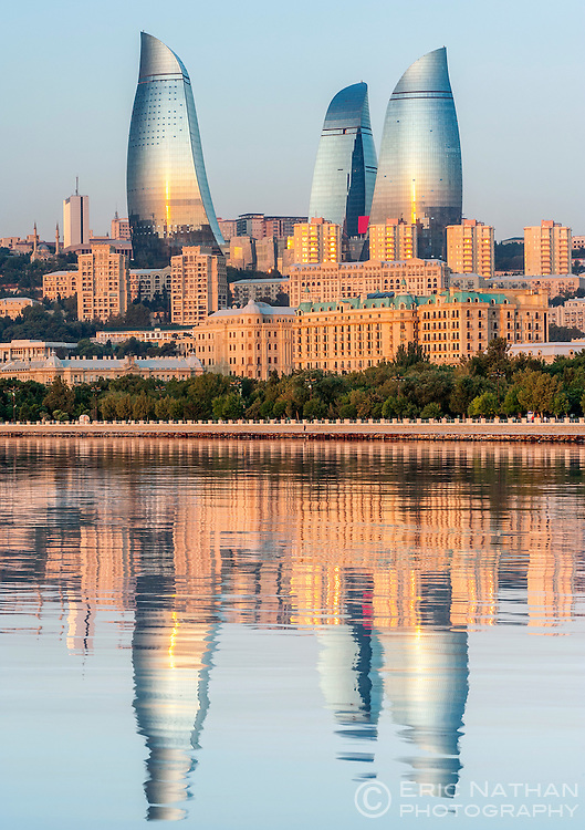 Dawn view of the Flame Towers reflected in the waters of Baku Bay in Baku, the capital of Azerbaijan.
