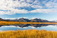 Reflection of Chugach Mountains in Knob Lake in the Matanuska Valley of Southcentral Alaska. Autumn. Morning.