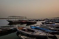 VARANASI, INDIA - CIRCA NOVEMBER 2016: Boats on the Ganges river early morning. The city of Varanasi is the spiritual capital of India, it is the holiest of the seven sacred cities in Hinduism and Jainism. The Ganges is also considered a sacred river.
