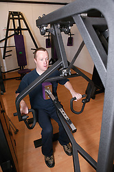 Access to services, Disabled man in the gym; using Seated Row,