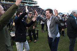 Racegoers celebrate during St Patrick's Thursday of the 2018 Cheltenham Festival at Cheltenham Racecourse.