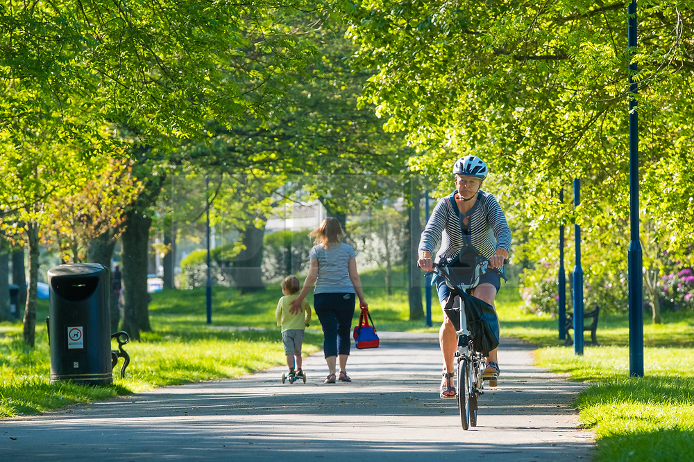 © Licensed to London News Pictures<br /> 21/05/2019 Aberystwyth UK.<br /> People cycling down the tree-lined Plas Crug park  on a bright sunny morning, at the start of yet another day of warm spring sunshine in Aberystwyth Wales. The weather is set fine for the coming days , with extended spells of warm sunshine, with temperatures reaching the low 20's Celsius in parts of the south east<br /> photo credit: Keith Morris/LNP