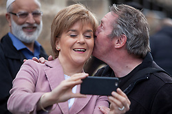 First Minister of Scotland and leader of the SNP Nicola Sturgeon, out on the election trail to make sure people are out voting today, May 7, 2015 in Glasgow, Scotland. With chef Arthur Keith at Craigie Street Pollokshields polling station.