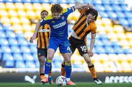 AFC Wimbledon midfielder Alex Woodyard (4) battles with Hull City midfielder George Honeyman (10) during the EFL Sky Bet League 1 match between AFC Wimbledon and Hull City at Plough Lane, London, United Kingdom on 27 February 2021.