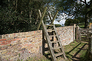 Ladder stile in Woodhall Park Estate in Watton at Stone, England, United Kingdom.