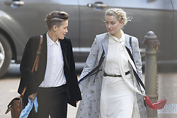 © Licensed to London News Pictures. 21/07/2020. London, UK. American actor AMBER HEARD (R) arrives with Bianca Butti at the High Court in London where Johnny Depp is in a legal dispute with UK tabloid newspaper The Sun over allegations he assaulted his former wife, Amber Heard. Photo credit: Peter Macdiarmid/LNP