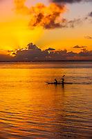 Sea kayaking at sunset, island of Moorea, French Polynesia.
