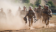 Marines run through the dirt during live-fire exercises for the 2nd Battalion, 5th Marine Regiment at Camp Pendleton.