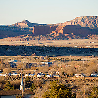 013113       Brian Leddy<br /> The village of Wingate spreads out in the valley below the red rocks at sunset Thursday afternoon.  Originally started as a trading post, the town and its homes sprung up from the business associated with the trading post.