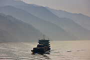 Transportation of cargo containers by boat in Three Gorges area, Yangtze River, China