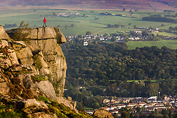 © Licensed to London News Pictures. 17/09/2020. Ilkley UK. A man stands on top of the Cow & Calf rocks 1,319ft above sea level in Ilkley this morning as Yorkshire looks set for another sunny day. Photo credit: Andrew McCaren/LNP