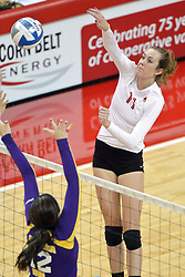 17 October 2014:  Eliza Smith strikes in the direction of Autumn Alitz during an NCAA Missouri Valley Conference (MVC) womens volleyball match between the Northern Iowa Panthers and the Illinois State Redbirds for 1st place in the conference at Redbird Arena in Normal IL