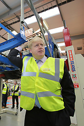© Licensed to London News Pictures. 29/02/2016. Antrim, Northern Ireland, Mayor of London, Boris Johnson MP, pauses during a tour of Wrightbus plant in Antrim,  Northern Ireland. Boris was visiting businesses that are supported by investment from Transport for London. Photo credit : Paul McErlane/LNP