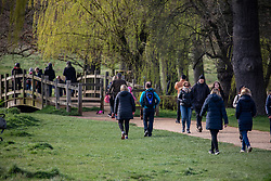 © Licensed to London News Pictures. 21/03/2020. London, UK. Walkers out in Richmond Park today. As the City centre empties, traffic jams build up in South West London, as walkers, runners and families descend on Richmond Park to exercise during the coronavirus crisis. Photo credit: Alex Lentati/LNP