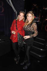 Left to right, ALICE DAWSON and VIOLET HENDERSON at a party to celebrate the publication of Cloak & Dagger Butterfly by Amanda Eliasch held at the Soho Revue Bar, London on 17th November 2008.