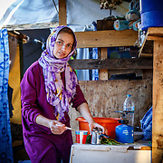A 28-year-old mother of four in her makeshift home. Ritsona Refugee Camp, Greece, July 2016.
