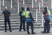 """An activist from the Palestine Action activist group is seen detained by the G4S security personnel after climbing a fence of Abu Dhabi National Exhibition Centre Excel in East London on Sunday, Sept 12, 2021. Activists who sprayed red paint at the G4S security firm's entrance tent are targeting an arms fair hailed as """"the world's largest gathering of the defence and security community"""". (VX Photo/ Vudi Xhymshiti)"""
