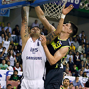 Efes Pilsen's Mario KASUN (L) and Fenerbahce Ulker's Gasper VIDMAR (R) during their Turkish Basketball league Play Off Final first leg match Efes Pilsen between Fenerbahce Ulker at the Ayhan Sahenk Arena in Istanbul Turkey on Thursday 20 May 2010. Photo by Aykut AKICI/TURKPIX