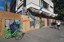 © Licensed to London News Pictures. 30/08/2020. London, UK. Barclays Bank on Ladbroke Grove boarded up in Notting Hill, West London, on the day of the 2020 Notting Hill Carnival which is bing held virtually this year due to COVID-19 restrictions. Members of the public have been warned against congregating in the Notting Hill Area to celebrate the event. Photo credit: Ben Cawthra/LNP