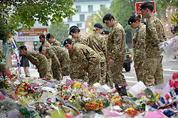 © London News Pictures. 31/05/2013. Woolwich, UK. Cadets from the Royal Artillery barracks in Woolwich visit the scene where Drummer Lee Rigby was killed in Woolwich, South East London. The  cadets laid flowers. Photo credit: Ben Cawthra/LNP