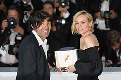 Diane Kruger, who won the award for best actress for her part in the movie 'In The Fade' (Aus Dem Nichts), and director Fatih Akin attend the Palme D'Or winner photocall during the 70th annual Cannes Film Festival held at the Palais Des Festivals in Cannes, France on May 28, 2017 as part of the 70th Cannes Film Festival. Photo by Nicolas Genin/ABACAPRESS.COM