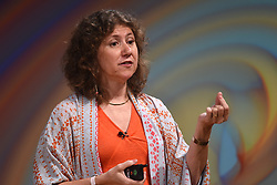 Professor Gabriela Gonzalez gives a lecture during the Stephen Hawking public symposium at Lady Mitchell Hall in Cambridge.