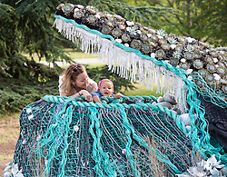 The Big Flower Fight<br /> At Kew Gardens, London, Great Britain <br /> press photo call <br /> 20th August 2020 <br /> <br /> Harriet Maxwell with daughter Rosa Fodio Todd aged 1 <br />  <br /> Andrew Whittle and Ryan Lanji of Netflix's 'The Big Flower Fight' beside one of their creations for the show<br />  <br /> A bespoke botanical sculpture of a magnificent humpback whale emerging from Kew's Orangery Lawn, created by the winners of hit original Series, 'The Big Flower Fight'.<br />                        <br /> The sculpture will be displayed 22 August – 18 September as part of Kew's 'Travel the World festival. <br />                             <br /> The living sculpture contains over 700 plants imitating the colours and textures of a humpback whale, including blue-tinged succulents and grasses.<br /> <br /> Photograph by Elliott Franks