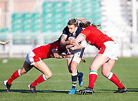 Rugby Union - 2021 Women's Six Name - Third Place Final - Scotland vs Wales - Scotstoun Stadium<br /> <br /> Chloe Rollie of Scotland is tackled by Gemma Rowland of Wales and Cerys Hale of Wales<br /> <br /> Credit: COLORSPORT/BRUCE WHITE