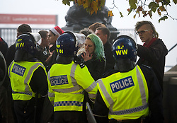 © Licensed to London News Pictures. 01/11/2015. London, UK. Ravers confront police at The scene where Riot police clashed with party goers at the site of an illegal halloween rave in London where it has been reported that a petrol bomb was thrown. Photo credit: Ben Cawthra/LNP