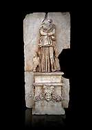 Roman Sebasteion relief sculpture of Ethnos of the Dacians Aphrodisias Museum, Aphrodisias, Turkey.   Against a black background.<br /> <br /> The Dacians are shown as a captive Barbarian woman. Her arms are crossed in submission, her thick dress slips off the shoulder slightly partly revealing her breast. The forepart of a small bull stands in profile behind. Dacia (modern Romania) was claimed by Augustus as a conquest in 1BC to 4AD .<br /> <br /> If you prefer to buy from our ALAMY STOCK LIBRARY page at https://www.alamy.com/portfolio/paul-williams-funkystock/greco-roman-sculptures.html . Type -    Aphrodisias     - into LOWER SEARCH WITHIN GALLERY box - Refine search by adding a subject, place, background colour, museum etc.<br /> <br /> Visit our ROMAN WORLD PHOTO COLLECTIONS for more photos to download or buy as wall art prints https://funkystock.photoshelter.com/gallery-collection/The-Romans-Art-Artefacts-Antiquities-Historic-Sites-Pictures-Images/C0000r2uLJJo9_s0