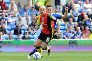 Birmingham's David Cotterill (foreground) is challenged by Cardiff City's Tom Lawrence. Skybet football league championship match, Cardiff city v Birmingham city at the Cardiff city stadium in Cardiff, South Wales on Saturday 7th May 2016.<br /> pic by Carl Robertson, Andrew Orchard sports photography.