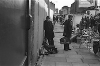 From Series of 7 Limited Edition (25) Large Framed Prints A3 Shot on film neg Black and White pictures Depicting Brick Lane Market London,  2 feb 1984 Photographer  Jack Ludlam<br />