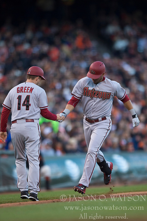 SAN FRANCISCO, CA - APRIL 18:  A.J. Pollock #11 of the Arizona Diamondbacks is congratulated by third base coach Andy Green #14 after hitting a home run against the San Francisco Giants during the fourth inning at AT&T Park on April 18, 2015 in San Francisco, California.  The San Francisco Giants defeated the Arizona Diamondbacks 4-1. (Photo by Jason O. Watson/Getty Images) *** Local Caption *** A.J. Pollock; Andy Green