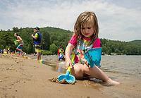 Making sand castles along the shore at Ellacoya State Park Beach.  (Karen Bobotas Photographer)