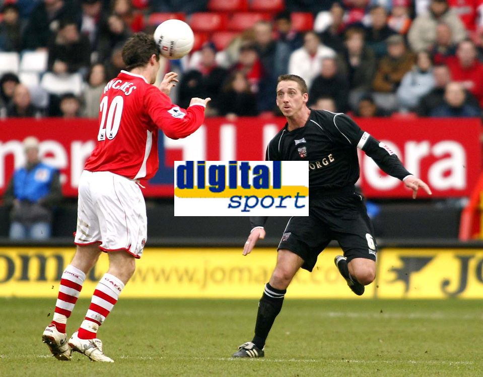Photo: Chris Ratcliffe.<br />Charlton Athletic v Brentford. The FA Cup. 18/02/2006.<br />Bryan Hughes of Charlton tussles with Ricky Newman of Brentford.