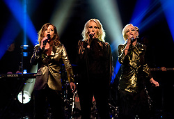 (left to right) Keren Woodward, Sara Dallin and Siobhan Fahey of Bananarama performing during filming of the Graham Norton Show at the London Studios, to be aired on BBC One on Friday evening.