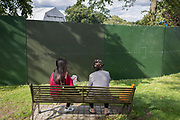 Brockwell Park users look at the view from their bench, during the Sunfall Festival, on 14th August 2017, in London, England.