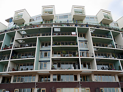 Modern architecture of new apartment building on Java Island new property development in Amsterdam Netherlands