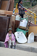Local residents searching through rubble for their belongings, on a broken road with trucks after a major lansdlide in La Paz in 2011 made around 25,000 people homeless, due to heavy rain and poor infrastructure, there were no fatalities and only minor injuries sustained