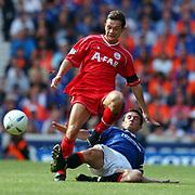 Rangers' Barry Ferguson slides in on Aberdeen's Derek Young